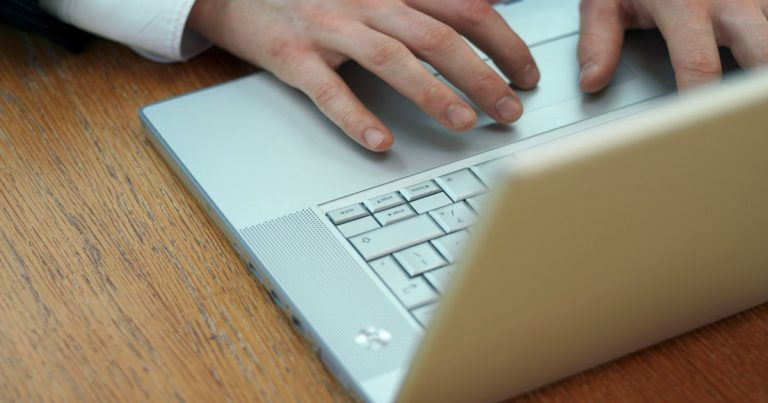 image of person typing on laptop protecting their privacy